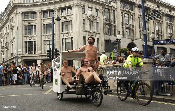 People cycle nude past Oxford circus as part of the World Naked Bike Ride on June 9 2007 in London England Rides took place in cities around the...