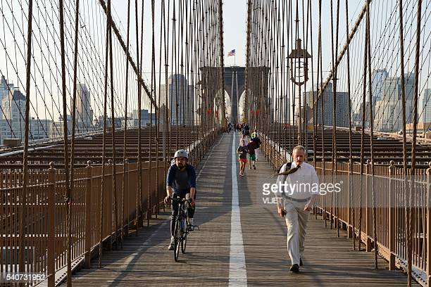 People cycling,walking and running on the Brooklyn Bridge