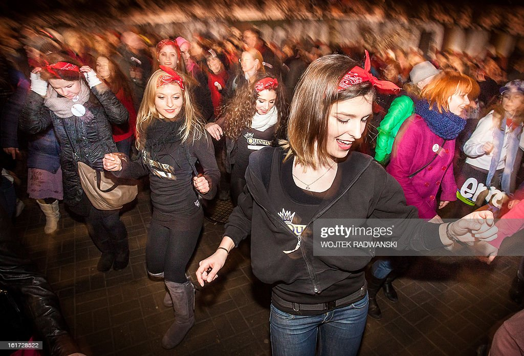People dance against sexual violence towards women and girls as part of the worldwide 'One Billion Rising' campaign on February 14, 2013 in Warsaw. In more than 200 countries worldwide, people took part in the campaign.