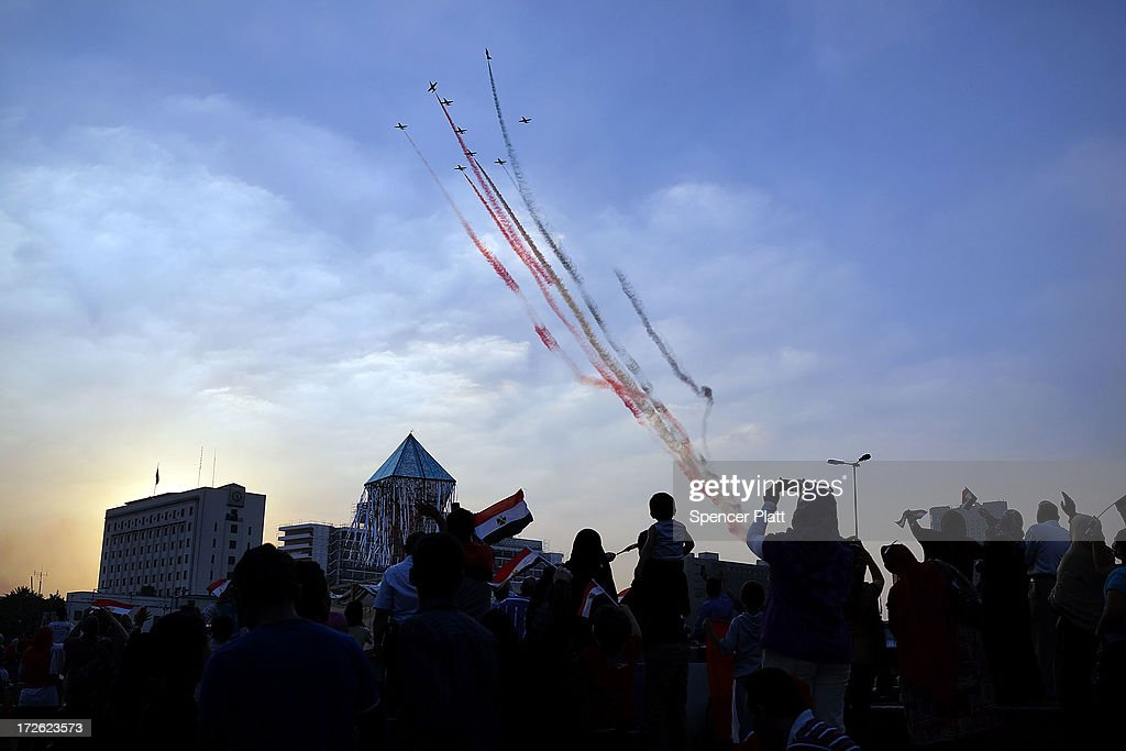People dance and cheer as Egyptian military aircraft fly over Tahrir Square, the day after former Egyptian President Mohammed Morsi, the country's first democratically elected president, was ousted from power on July 4, 2013 in Cairo, Egypt. Adly Mansour, chief justice of the Supreme Constitutional Court, was sworn in as the interim head of state in ceremony in Cairo in the morning of July 4, the day after Morsi was placed under house arrest by the Egyptian military and the Constitution was suspended.