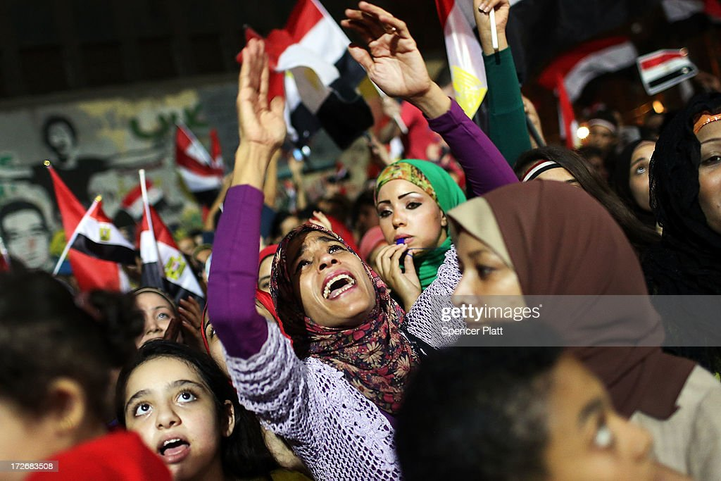 People dance and cheer in Tahrir Square, the day after former Egyptian President Mohammed Morsi, the country's first democratically elected president, was ousted from power on July 4, 2013 in Cairo, Egypt. Adly Mansour, chief justice of the Supreme Constitutional Court, was sworn in as the interim head of state in ceremony in Cairo in the morning of July 4, the day after Morsi was placed under house arrest by the Egyptian military and the Constitution was suspended.