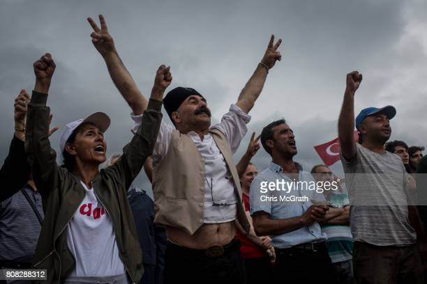 People dance and shout slogans after marching from Izmit to Korfez and arriving at the overnight campsite setup for supporters taking part in the...