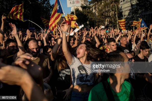 People dance and sing songs as thousands of citizens gather in Plaza Universitat during a regional general strike to protest against the violence...