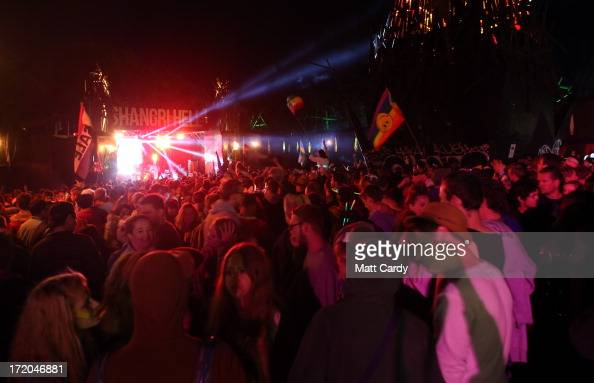 People dance at a stage in the ShangriLa area of Glastonbury Festival of Contemporary Performing Arts site at Worthy Farm Pilton on July 1 2013 near...