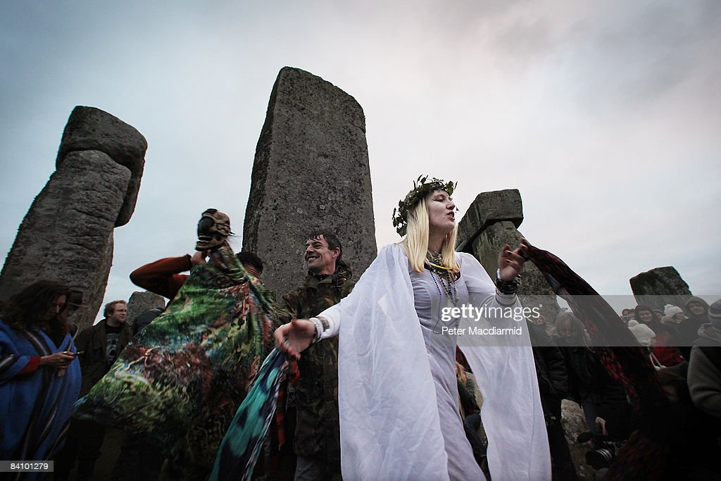 People dance at Stonehenge on December 21, 2008 in Wiltshire, England. Hundreds of people gathered at the famous stone circle to watch the sun rise on Winter Solstice - the shortest day of the year.