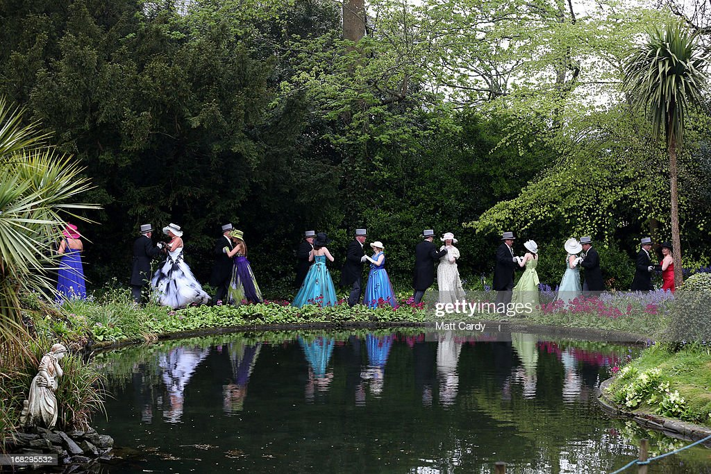 People dance beside the lake in the grounds of Lismore House and Gardens in the centre of Helston, as they take part in the midday dance to celebrate Helston Flora Day on May 8, 2013 in Cornwall, England. The annual Flora Dance, also known as the Furry Dance, is one of the UK's oldest customs still practised today and is said to be a celebration of the passing of Winter and the arrival of Spring. A series of dances take place throughout the day, beginning at 7am, all over the Cornish town and even in and out of private houses and shops. However the highlight is the midday dance which was traditionally the dance of the gentry in the town and is why men still wear top hats and tails while the women dance in their finest dresses.