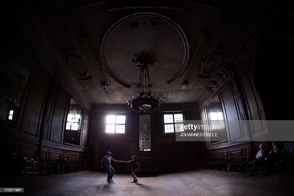 People dance during a lesson in the Spiegelsaal (hall of mirrors) at Claerchens Ballhaus on July 10, 2013 in Berlin.