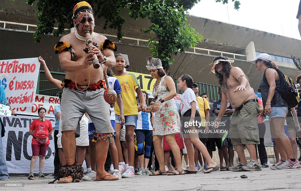 People dance during a protest against the demolition of the Celio de Barros track and field stadium in Rio de Janeiro, Brazil on January 13, 2013. The stadium needs to be demolished to carry out the Maracana stadium construction plans ahead of the 2013 FIFA Confederations Cup, 2014 FIFA World Cup and 2016 Olympic games. AFP PHOTO/VANDERLEI ALMEIDA