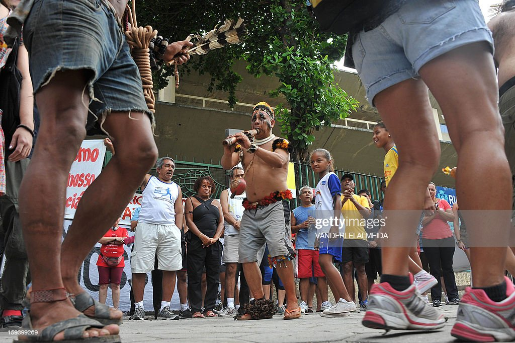 People dance during a protest against the demolition of the Celio de Barros track and field stadium in Rio de Janeiro, Brazil on January 13, 2013. The stadium needs to be demolished to carry out the Maracana stadium construction plans ahead of the 2013 FIFA Confederations Cup, 2014 FIFA World Cup and 2016 Olympic games.