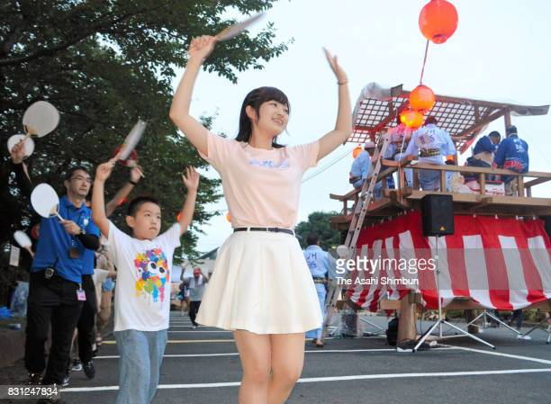 People dance during the 'Bon Odori' festival at Namie City Hall on August 13 2017 in Namie Fukushima Japan The Obon or Bon season to honour ancestors...