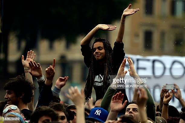 People dance during the worker's day concert on May Day in Rome's Piazza San Giovanni on May 1 2012 AFP PHOTO / Filippo MONTEFORTE