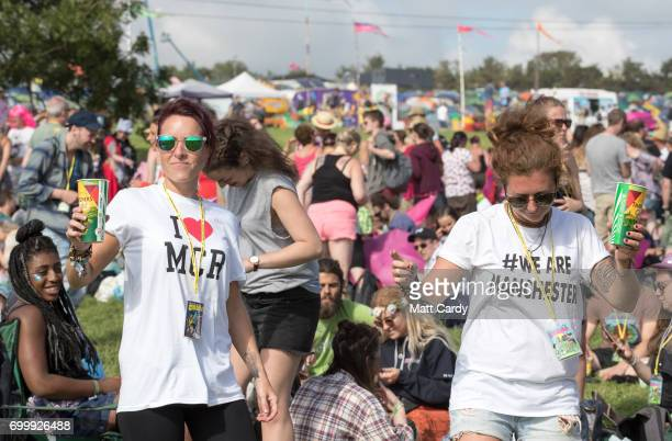 People dance in front of the Pyramid Stage at the Glastonbury Festival site at Worthy Farm in Pilton on June 22 2017 near Glastonbury England The...