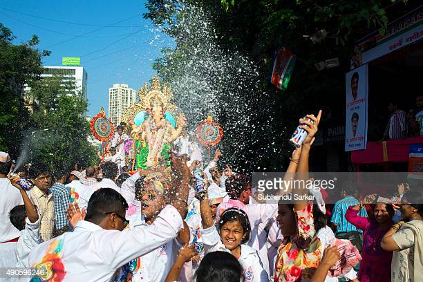 People dance moving in a procession when the idol of lord Ganesha is being taken for immersion There is a lot of fervour surrounding Ganapati...