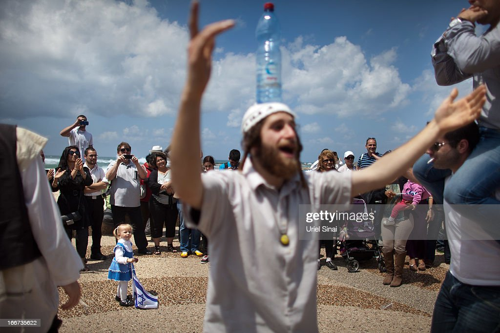 People dance on the beach as they celebrate the 65th anniversary of Israel's independence on April 16, 2013 in Tel Aviv, Israel. The day marks when David Ben-Gurion, the Executive Head of the World Zionist Organization declared the establishment of a Jewish state in Eretz- Israel.