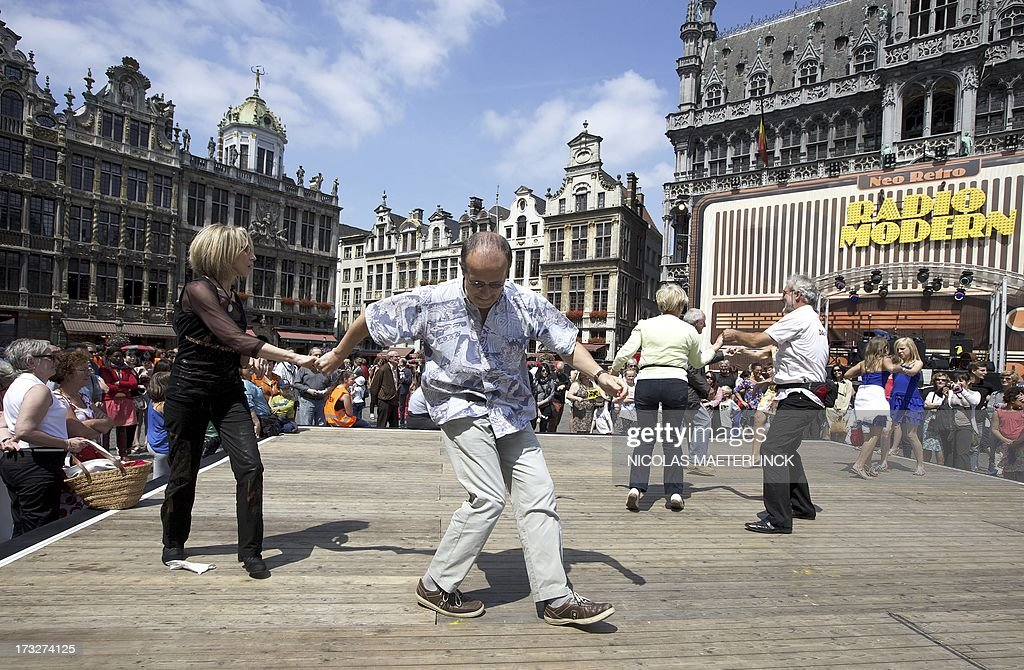People dance on the Grand-Place (Grote Markt) square in Brussels during the 'Brussel Danst' (Brussels Dances), a celebration of the Flemish regional holiday on July 11, 2013.