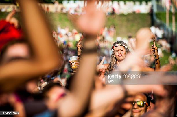 People dance on the second day of the 9th edition of the Tomorrowland music festival on July 27 2013 in Boom running from July 26 to 29 AFP PHOTO /...