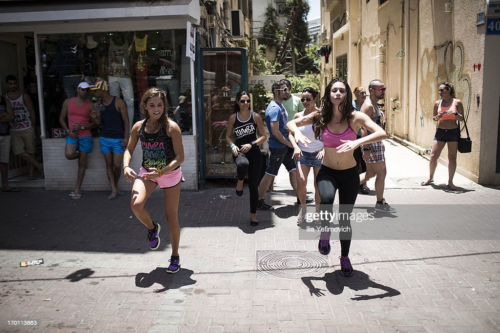 People dance on the street during the annual Tel Aviv Gay Pride parade on June 7, 2013 in Tel Aviv, Israel. Thousands of people gathered in Tel Aviv for the parade, which attracts visitors from all over the world.