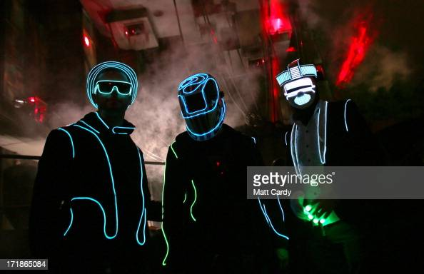 People dance outside a nightime venue in the Block 9 area at the Glastonbury Festival of Contemporary Performing Arts site at Worthy Farm Pilton on...