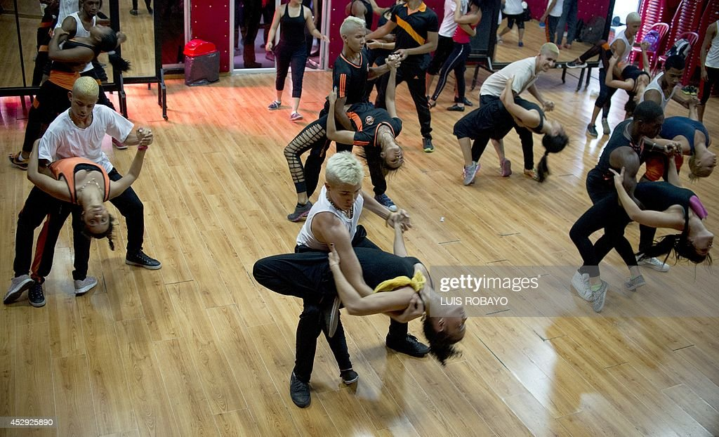 People dance salsa at the Swing Latino dance school in Cali Colombia on July 26 2014 The outstanding performance of Colombia's national football team...