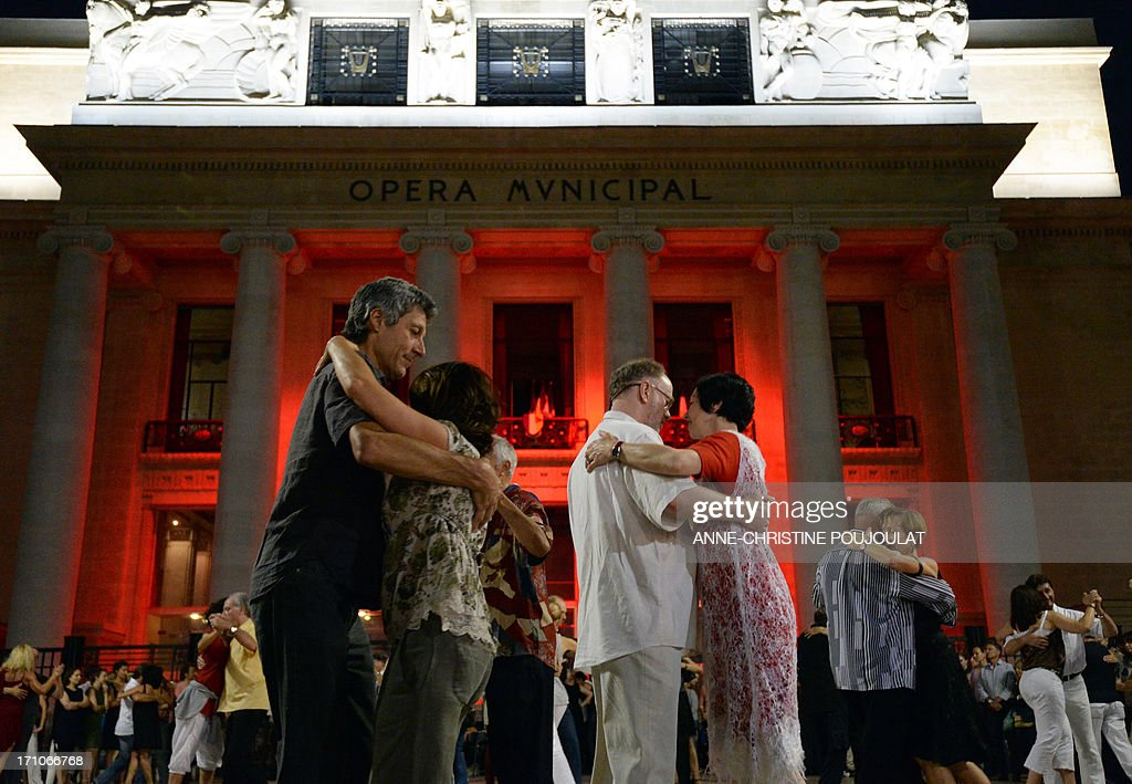 People dance tango in front of the opera house in Marseille, southern France, on June 21, 2013 during the 32nd edition of the annual music event 'La Fete de la Musique' . The event takes place across the streets of France, with thousands of musicians performing for one of the nation's most popular festivals celebrating rythm and sound.