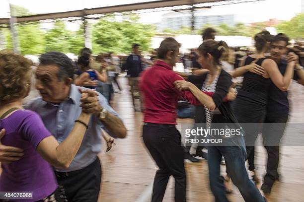 People dance tango on August 24 2014 on the last day of the 13th edition of ParisPlages at the Grande Halle de La Villette in Paris AFP PHOTO / FRED...