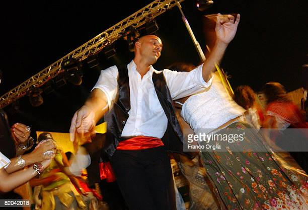 People dance the Pizzica Local dance in Cannole during the 'Municedda' festivity on August 14 in Salento Italy Salento is that strip of land that...