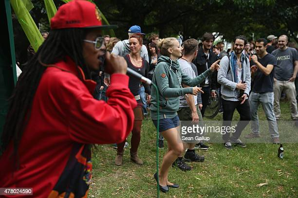 People dance to a reggae singer in Kreuzberg district during the annual 'Fete de la Musique' music fest on June 21 2015 in Berlin Germany During...