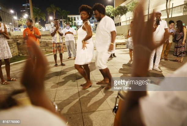 People dance to AfroBrazilian music at the Valongo slave wharf entry point in the Americas for nearly one million African slaves on July 17 2017 in...