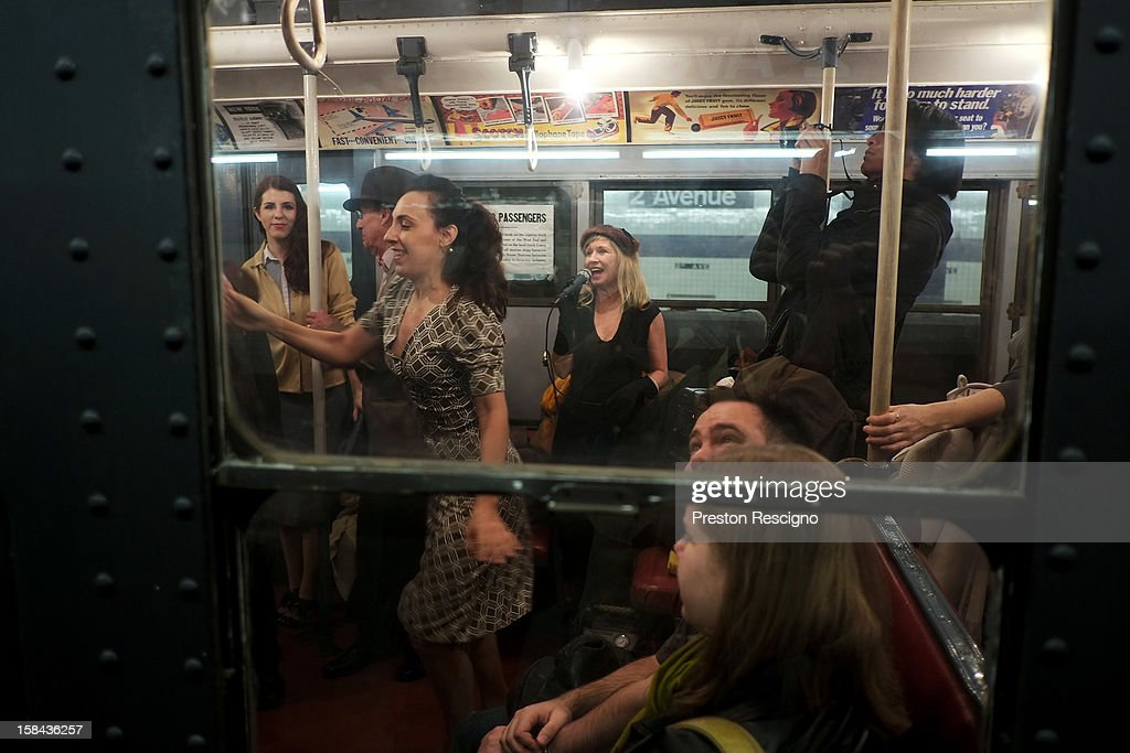 People dance to live music in a vintage New York City subway car as it sits in the 2nd Ave. station on December 16, 2012 in New York City. The New York Metropolitan Transportation Authority (MTA) runs vintage subway trains from the 1930's-1970's each Sunday along the M train route from Manhattan to Queens through the first of the year.