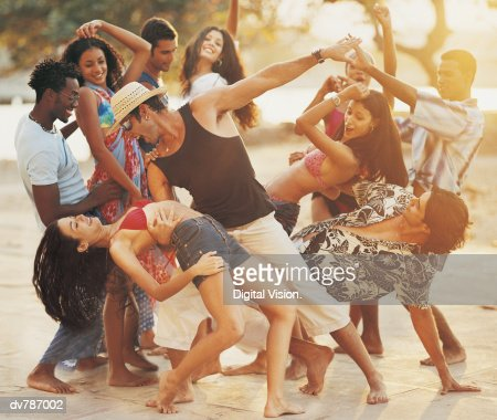 People Dancing at a Beach Party : Foto stock