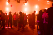 Blurred shot of people dancing on the dance floor in a nightclub.