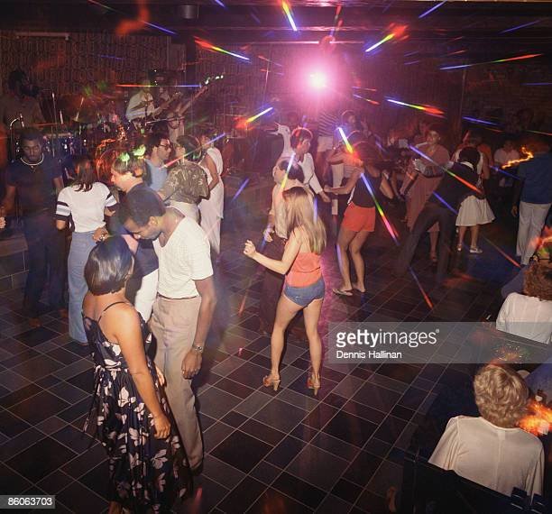 People dancing at disco nightclub