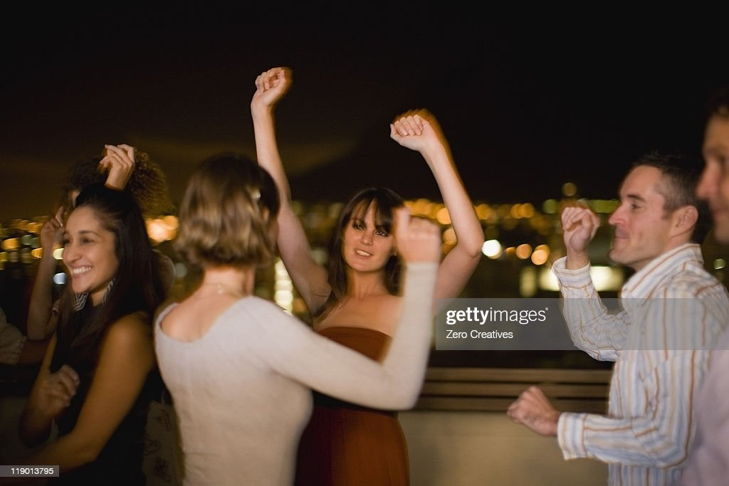People dancing at party at night : Stock Photo