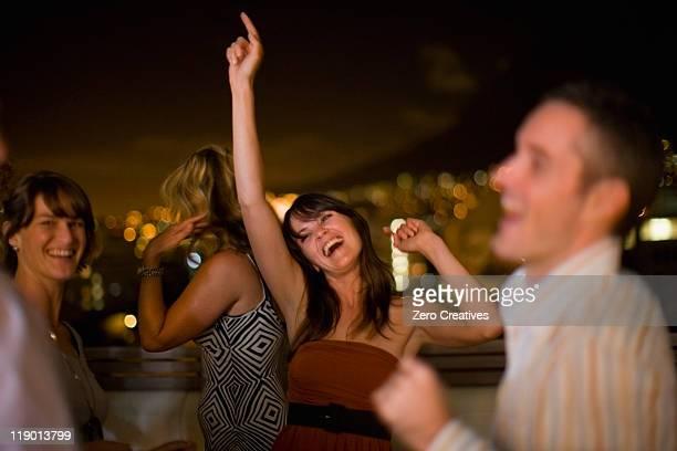 People dancing at party at night