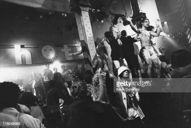 People dancing at The Hacienda in Manchester at a popular acid house night 'Hot' July 1988