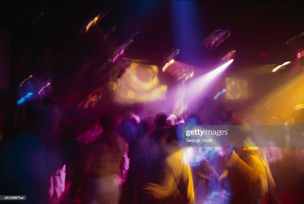 people dancing in a discotheque (toned) : Stock Photo
