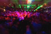 People dancing in disco (blurred motion)