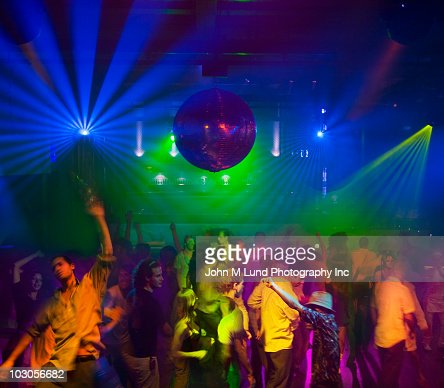 People dancing in nightclub : Stock Photo