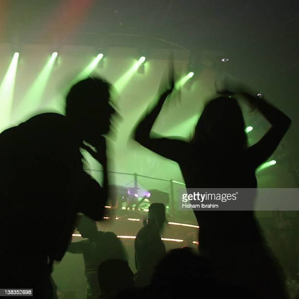 People dancing on a dance floor at a nightclub