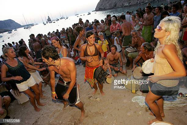 People dancing Sunset beach party Benirras Beach Ibiza July 2006