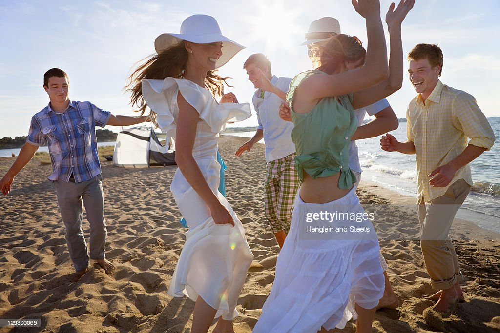 People dancing together on beach : Stock Photo