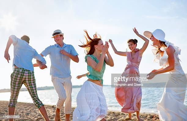 People dancing together on beach