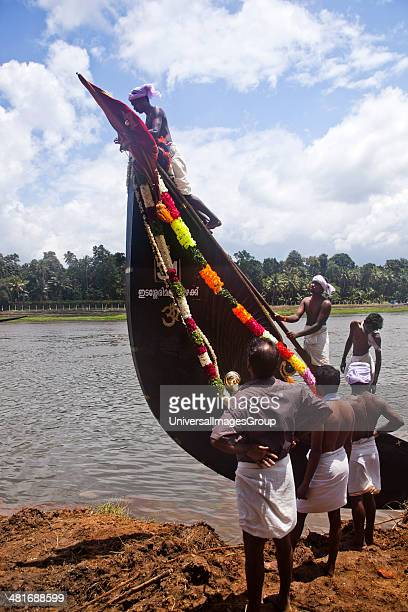 People decorating a Snake boat during Onam Festival Aranmula Kerala India