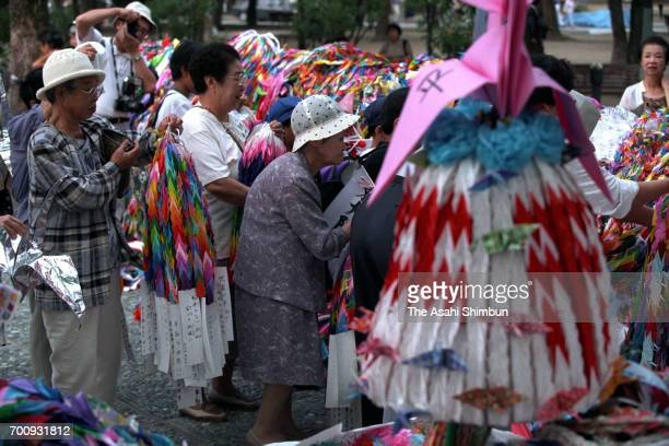 People dedicate paper cranes on the 50th anniversary of the atomic bomb dropped at Hiroshima Peace Memorial Park on August 6 1995 in Hiroshima Japan