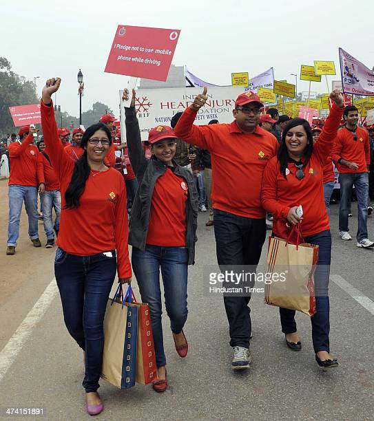 People Delhi police personnel and school students participate in the Road safety march organised by Delhi Traffic police on road safety during the...