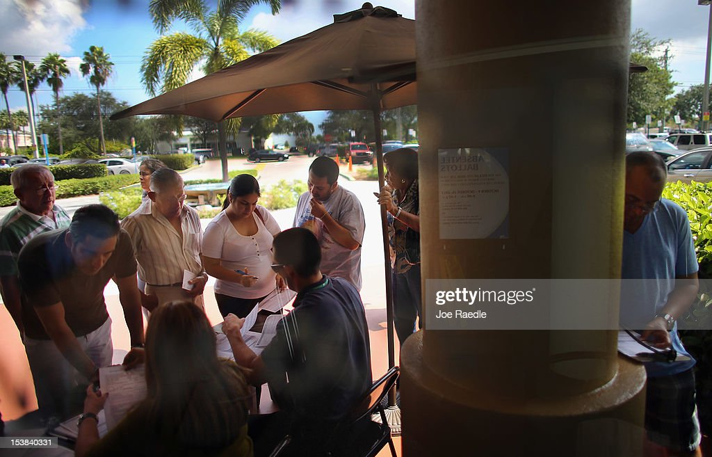 People deliver their voter registration forms to MiamiDade Elections Department officials on the final day for voters to register to vote in the...