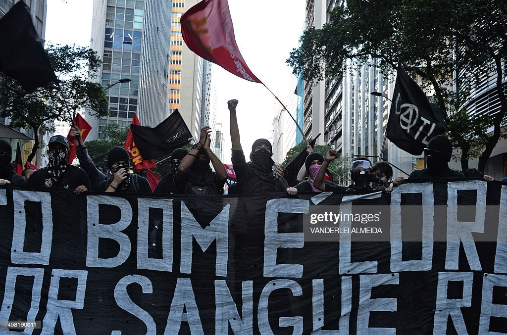 People demonstrate against a public transport fare hike announced for January 2014 by Rio de Janeiro's Mayor Eduardo Paes, in the streets of the Brazilian city, on December 20, 2013.
