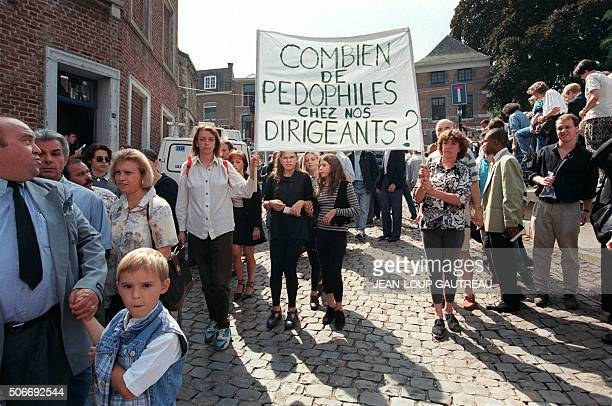 People demonstrate against Belgian government after the funeral ceremony of Melissa Russo and Julie Lejeune at Liege's Saint Martin Basilica 22...