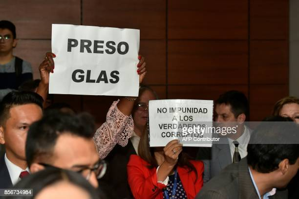 People demonstrate against Ecuadorean VicePresident Jorge Glas allegedly caught up in the Odebrecht scandal before a hearing in which prosecutor...