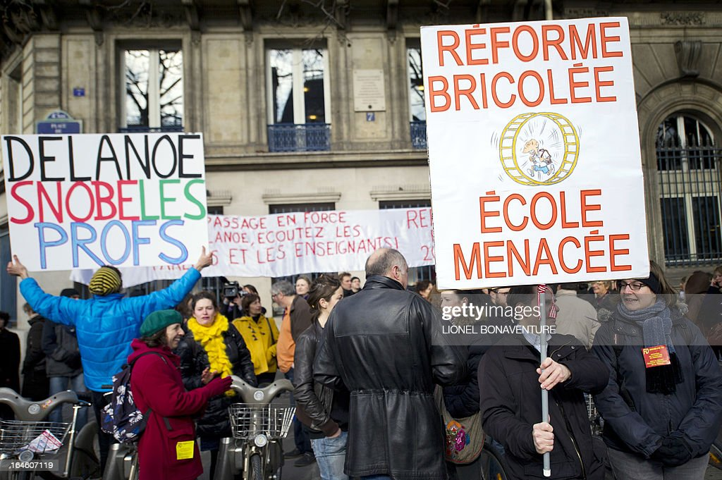 People demonstrate against the application for the 2013-2014 schoolyear of a reform law increasing the class time of primary school students in front of Paris' city hall, on March 25, 2013, as Paris' municipal council gathers to vote the law's application.